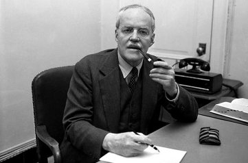 Alan Dulles posing with pen and pipe